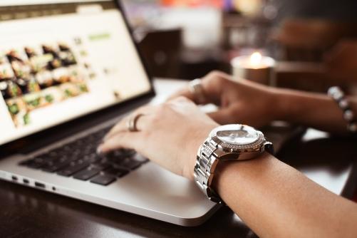 girl-with-watches-typing-on-macbook-picjumbo-com.jpg